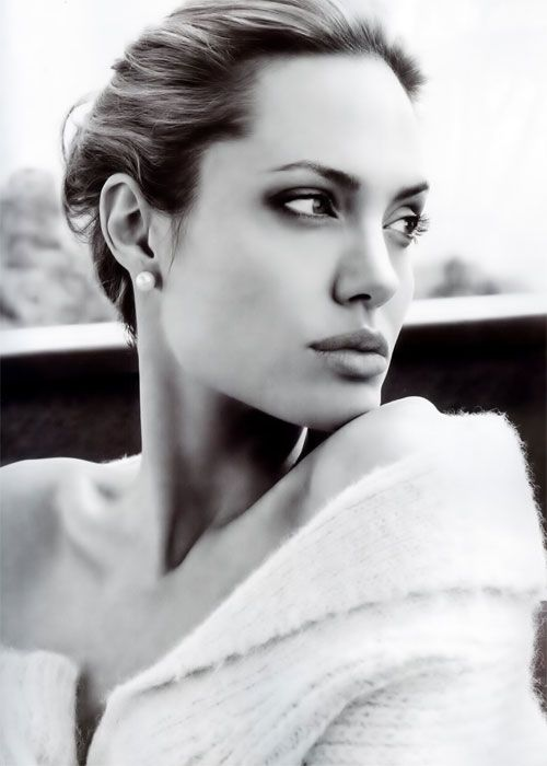 Angelina Jolie.  I sort of...you know...LOVE her.  :)