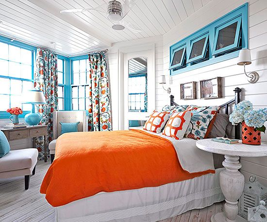 bright orange and cool teal steal the show in this bedroom find more colorful rooms
