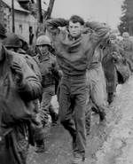 [Photo] American prisoners marching along a road somewhere on the western front, Dec 1944