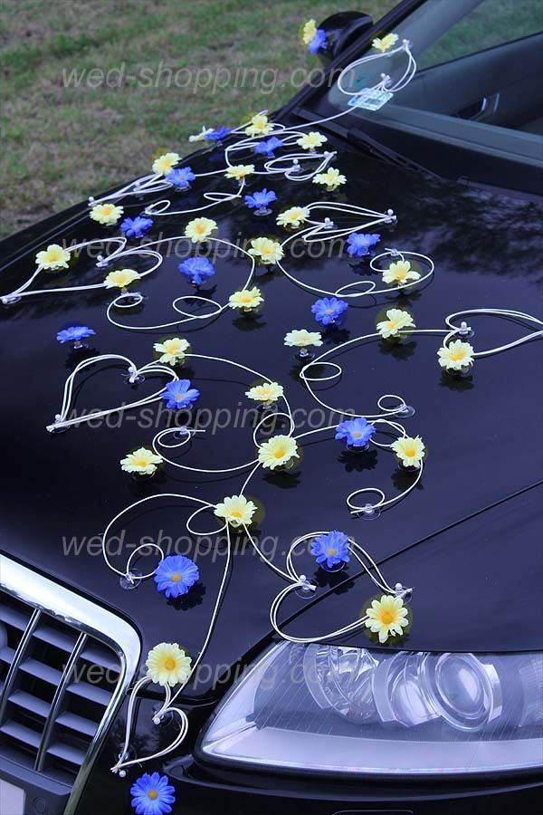 Wedding Decoration for Car  yellow-blue Daisies. The entire decoration is mounted on suction cups that are safe for the paint. It is har to find something similar to buy it.