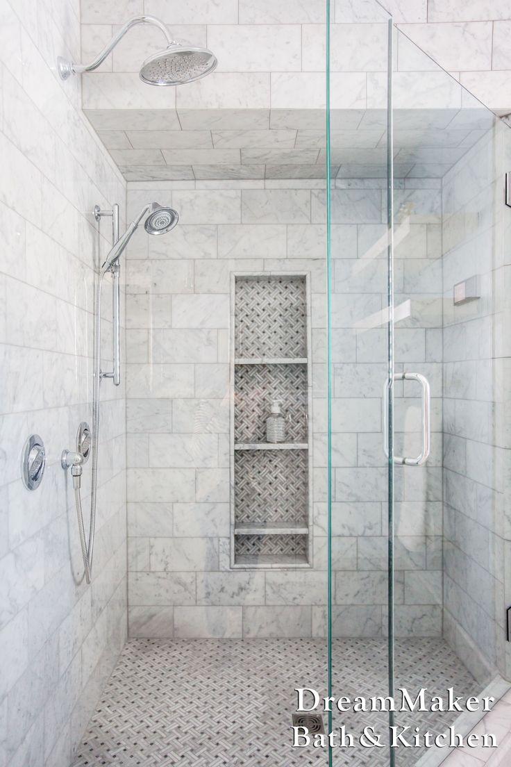 Marble tile shower. Chrome fixtures. Mosaic accent tile