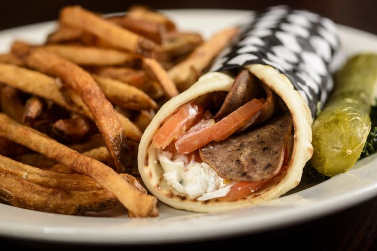 Beef Gyros | thinly sliced seasoned beef wrapped in a pita with onions, tomatoes and our homemade tzatziki sauce. Served with french fries.