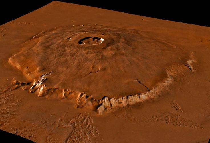 Le volcan Olympus Mons reconstitué en 3 dimensions grâce aux données des sondes Vikings et de l'altimètre de Mars Global Surveyor. Culminant à plus de 21 kilomètres au dessus du niveau moyen de la planète, sa majesté Olympus Mons est le plus grand volcan de Mars et même du système solaire ! Si Olympus Mons, et les volcans martiens de type  boucliers  sont aussi grands, c'est parce que la croûte martienne est restée fixe au dessus du point chaud alimentant le volcan pendant des centaines de…