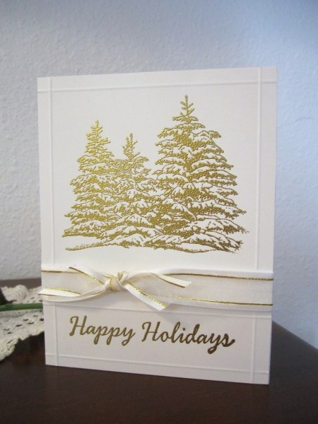 Artist:  Claudia Rainda  One layer Christmas card - Hero Arts stamp embossed with gold accented with a GKD ribbon.