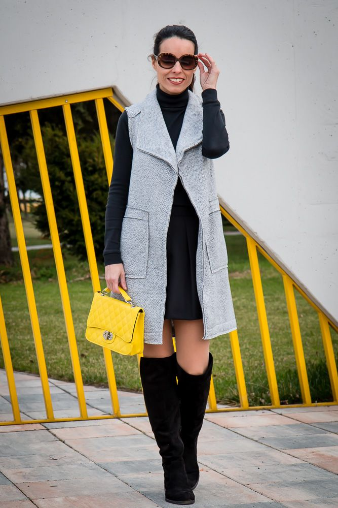 Grey vest & yellow bag