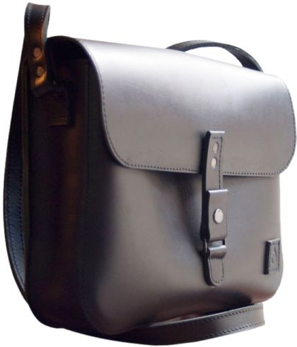 Leather bag with soft black interior pocket, card holder and back zipper pocket. Color and hue of Disappear's products may be slightly different from one to another due to the nature of the material and manufacturing. This makes each disappear creation so unique.   Dimensions: 21x28x6 cm; back pocket 13x28 cm; strap 2cm