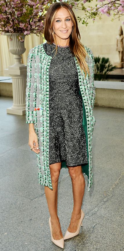 Sarah Jessica Parker stepped out in an embellished olive green brocade fit-and-flared dress topped with a woven mint green outfit-making coat. Nude pumps completed her look.