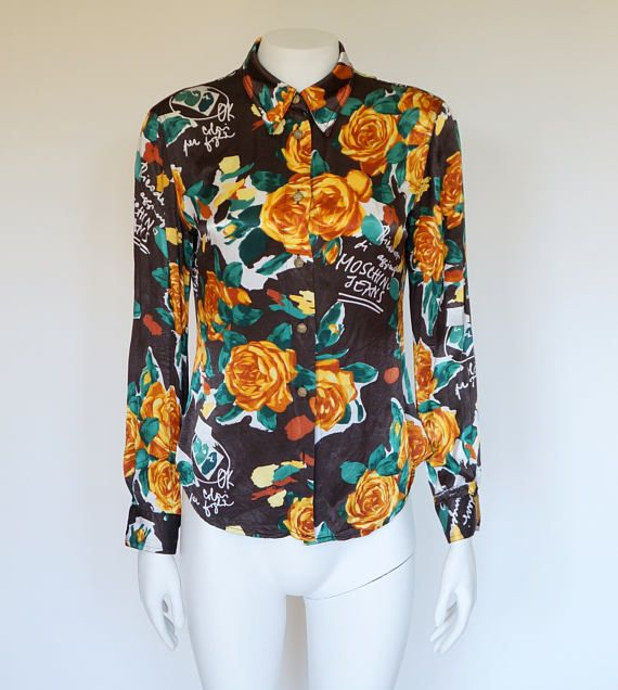 Im happy youre here VINTAGE PANDORA  I offer vintage MOSCHINO JEANS blouse 100% authentic  Made in Italy print:roses size on tag I44 USA10 F40 GB14 D40 100% viscoza used in very good condition-1 button missing   total length 63 cm/ 24,80 inch length from armpit 34 cm/ 13,39 inch width shoulders 41 cm/ 16,14 inch width armpit to armpit 48 cm/ 18,90 inch length sleeves 59 cm/23,23 inch length sleeves from armpit 46 cm/18,11 inch   If you have any question write to ...