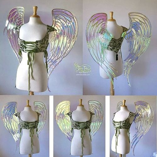 These were commissioned for Gregangelo of Velocity Circus. He wanted angel shaped wings made with the materials I usually use. It was challenging to me to get the right look to translate a feather wing design to iridescent film and cut aluminum sheet. I m | Flickr - Photo Sharing!