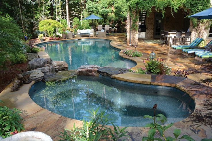 I love this idea of a big (deep) pool and a little shallow pool...even though this one looks like a hot tub. A little shallow pool would be great to keep the littles out of the trouble areas!