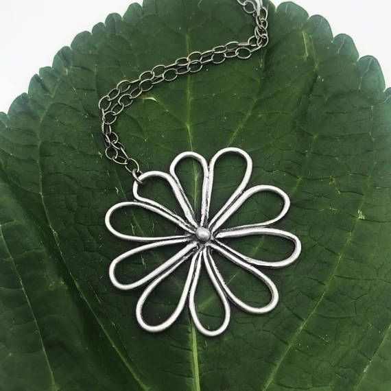 Receiving real flowers is a wonderful feeling, but opening up a jewelry gift box with this eternal silver flower is even better. Whimsical with an air of elegance, this handcrafted sterling silver pendant necklace is perfect for your free-spirit. Finished with a sterling silver