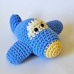 Pattern for sale.  Very cute...though I would add the horizontal stabilizers (wings) on the tail.