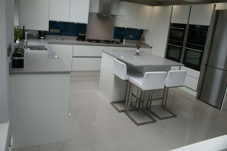 ultragloss-white-with-quartz-surfaces-porcelain-floor-glass-splashback-and-neff-appliances-with-a-quooker-tap5