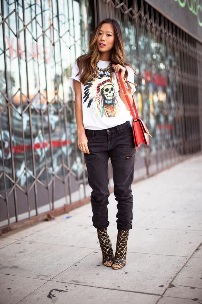 40 Amazing Baggy Jeans Outfit Ideas - Blogger Aimee Song wearing a graphic t-shirt tucked into baggy black jeans and worn with peep toe ankle boots + a red leather bag