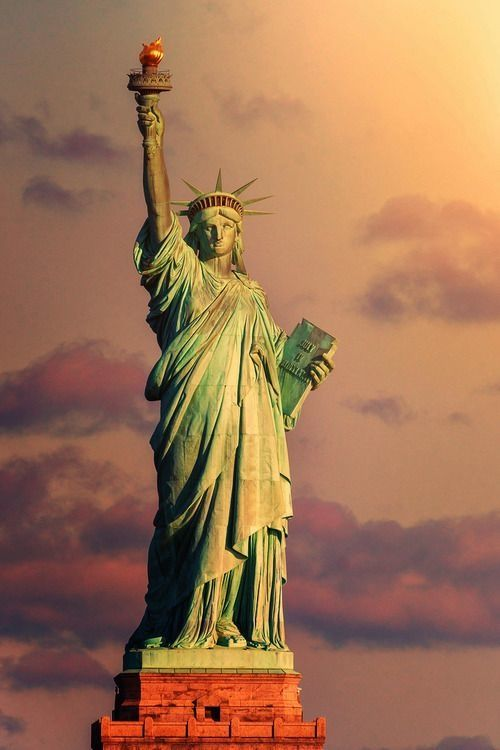 State of Liberty - The copper statue is of a robed female figure representing Libertas, the Roman goddess, who bears a torch and tablet which is inscribed with the date of the American Declaration of Independence, July 4, 1776. A broken chain lies at her feet.