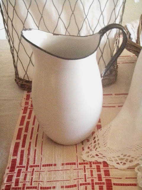 Love enamelware-I use my pitcher like this every morning to water the flowers in my hanging planters.
