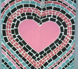 Art project using construction paper to make Valentine Mosaics