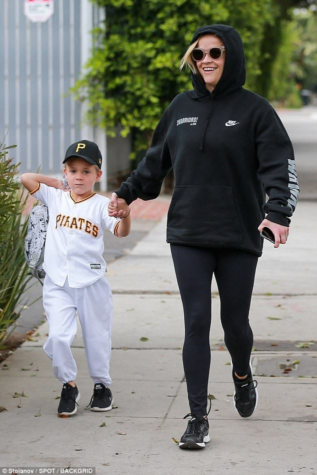 Close:The 41-year-old actress covered up in a hoodie in leggings while her youngest child donned a Pirates jersey with a matching baseball cap