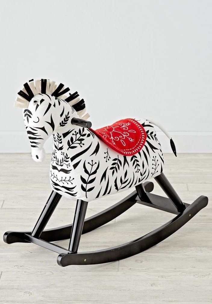 Shop Zebra Rocking Horse.  What's black and white and rocks? Our zebra rocker, of course.  (Okay, not our best joke…) The plush body, wooden base, and unique zebra design make it better than your average rocking horse.
