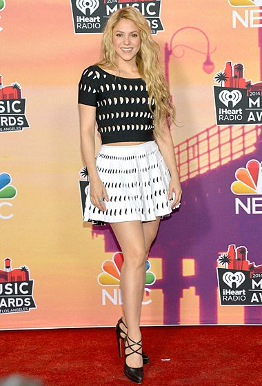 Shakira dazzles in a black-and-white Alaia skirt and top and Casadei heels at the 2014 iHeartRadio Music Awards