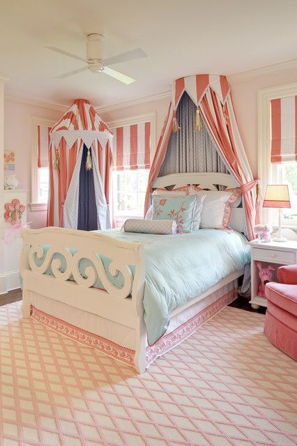 Soft blue and coral bedroom with circus style canopies- big girl room
