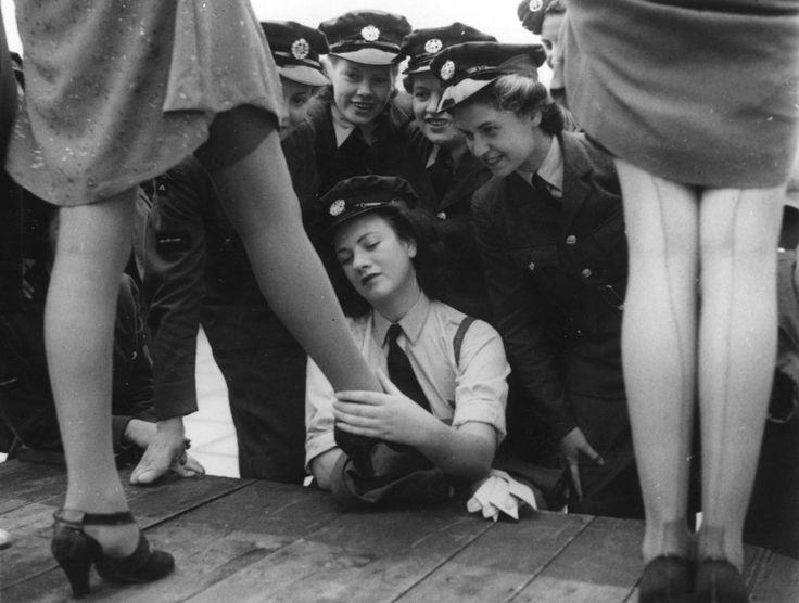 admiring the stockings. 1940's.