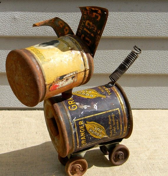 Dog upcycled from aluminum cans.