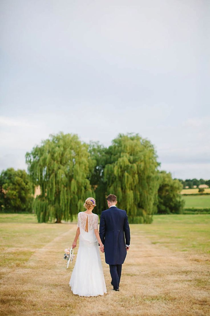 Bride Sarah wears a dropped waist gown by Stephanie Allin for her English country garden wedding. Photography by Joanna Brown.