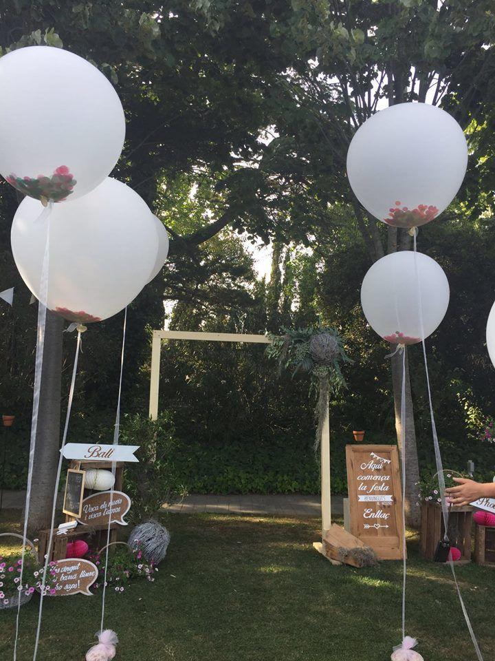 decoració de photocall amb globus XL plens de confeti