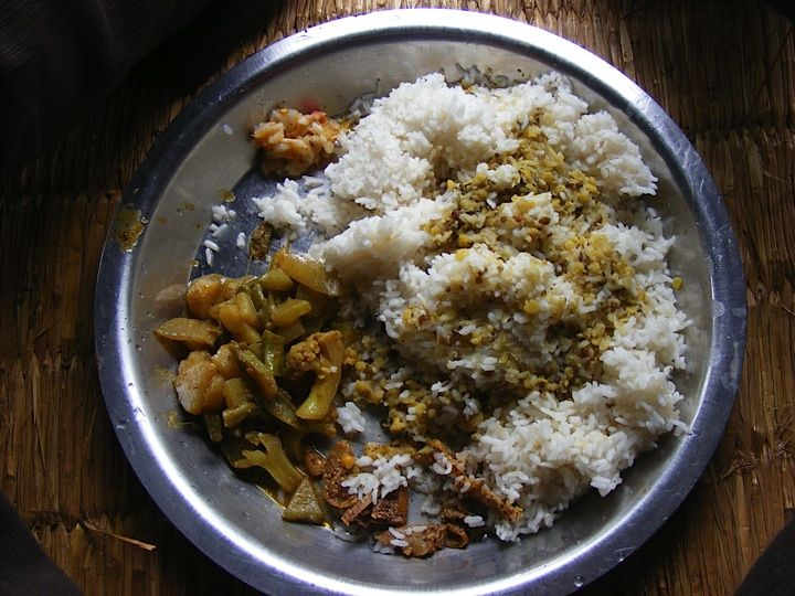 Dal Bhat, the national dish of Nepal.  It means Rice and Lentils soup, then its served with some curried vegetables and some lovely mystery 'pickle.'  The 'pickle' can refer to any chutney like substance.