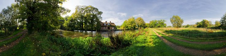 This is the River Test which features in Richard Adams' novel Watership Down. The nearby village of Mottisfont has a National Trust property which is a very popular tourist trap.The actual Watership Down is near Kingsclere village.