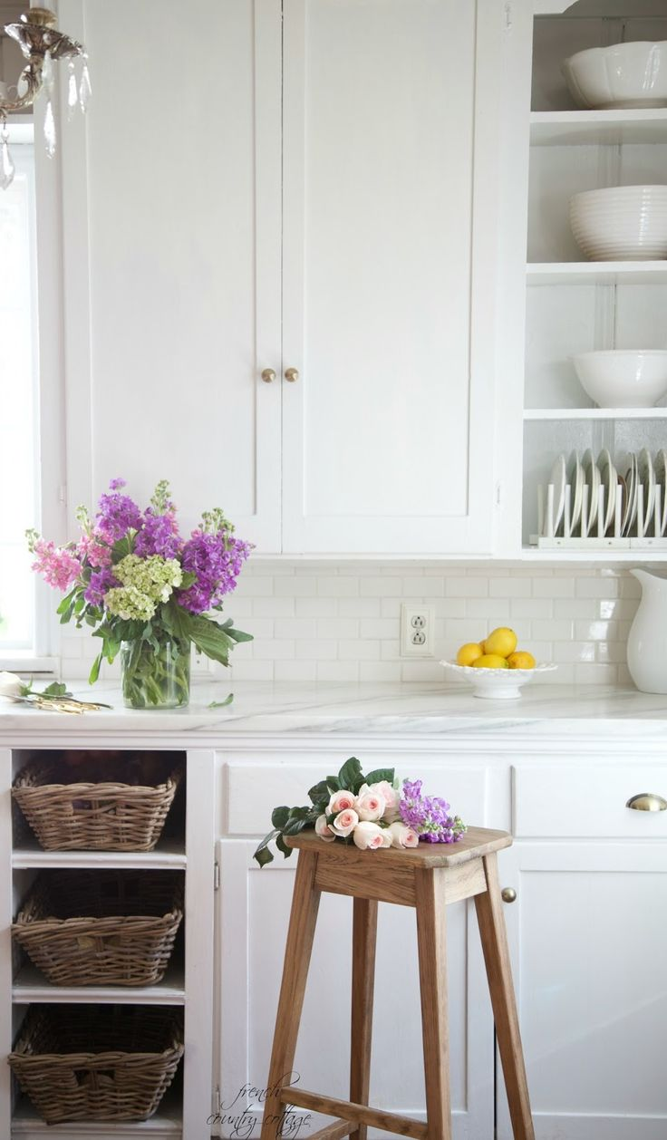 White Marble counters, farmhouse sink, chunky baskets and farm stool