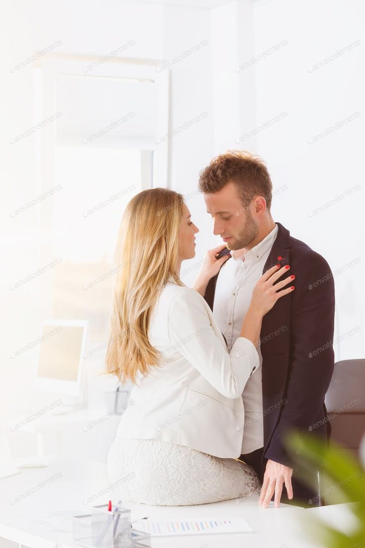 Couple having an affair at work by bialasiewiczs photos