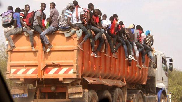 Grand Magal, Touba. Men sitting on top of a lorry. Pilgrims show remarkable dedication to make it to Touba. Sénégal