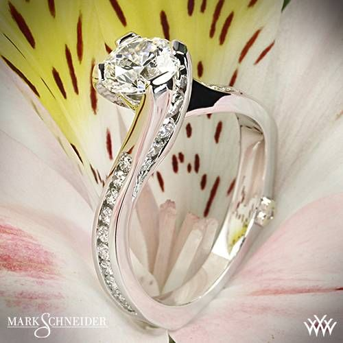 The Mark Schneider Irresistible Diamond Engagement Ring was designed to show how simply powerful love is. This beauty features 27 Round Brilliant Diamond Melee (0.515ctw; F/G VS) that are channel-set along the shank and also line the slight twist as the prongs reach the center stone. The look is finished off by the signature Round Brilliant Diamond Melee (0.005ctw; F/G VS) nestled within the