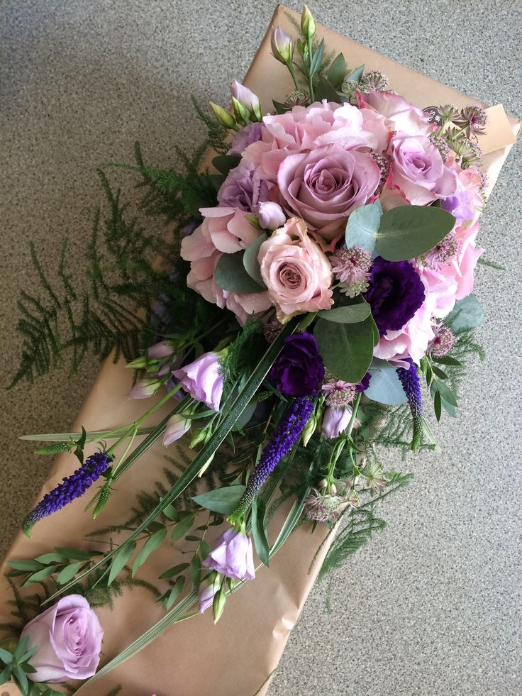Pink Hydrangea, Memory Lane Roses, blue Lisianthus, blue Veronica, Faith Roses, Parvi Eucalyptus, Asparagus Fern. Shower Bridal Bouquet.