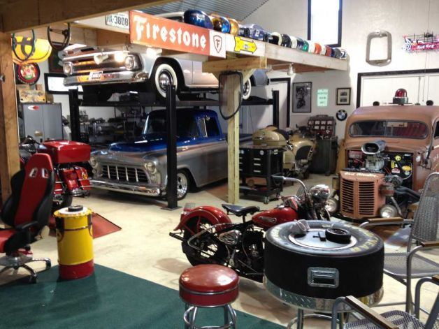 AWESOME Garage complete w/ multiple hot rods, car storage lifts & pimped out chillen space!! ...A girl can dream, lol ;)