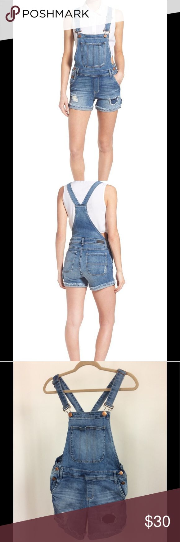 "STS Blue Distressed Short Overalls, Shortalls STS Blue distressed short overalls.  Size 5 (Description says 6, because ""5"" isn't given as an option) 15"" waist, 9"" rise, 5"" inseam. 98% cotton, 2% spandex. Stretch-denim cutoff overalls feature a traditional bib-and-brace front and v-back design with distressed threadbare patches adding a lived-in feel.  Adjustable shoulder straps with buckle closures, two-button side closures, four-pocket style, bib pocket.  In very good used condition! STS…"