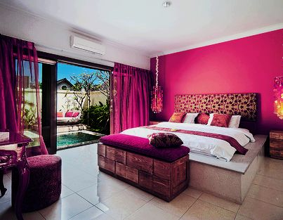 girls room with hot pink wall and curtains extra storage
