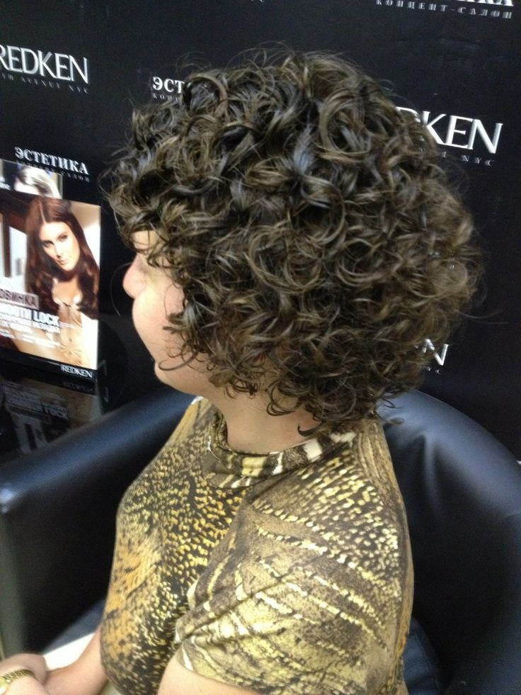 big curls in a short permed hairstyle
