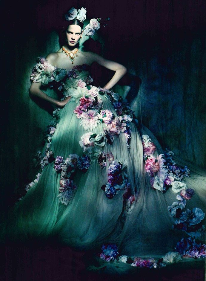 Mesmerizing Beauty The shadowy lighting steals the innocence from her gown. She dares you to linger...