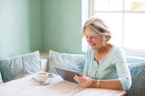 Senior woman looking at tablet computer