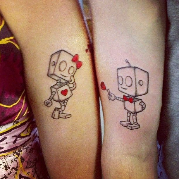 Cute His and Her Robot Couple Tattoo on Hand   Cool Tattoo Designs