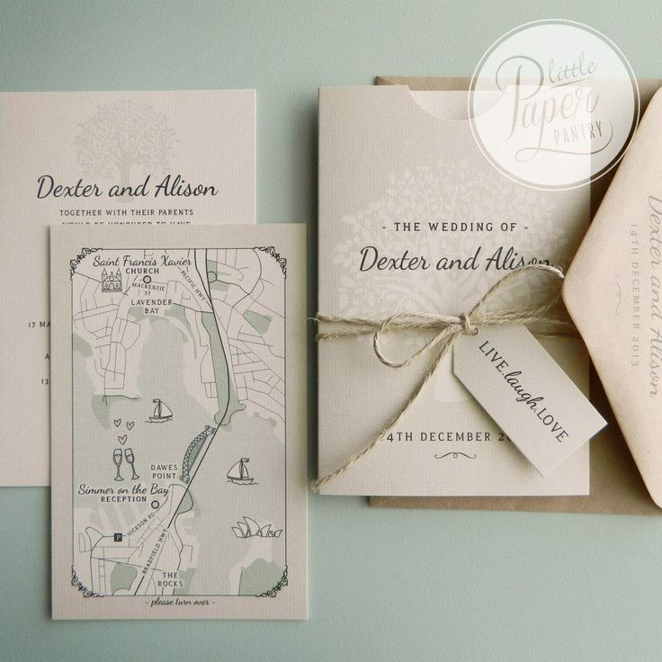 A6 pocket invite and wedding map with a tree of life design, natural twine bow and a luggage tag.