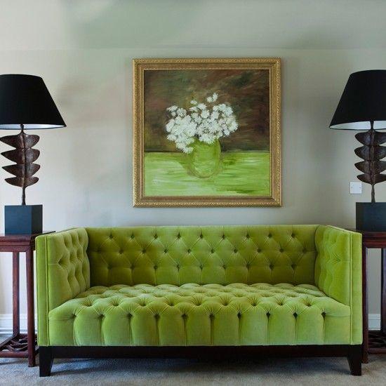 Upholstered lime sofa contrasts with black lamps. #pantone #pantonecoloroftheyear #greenery
