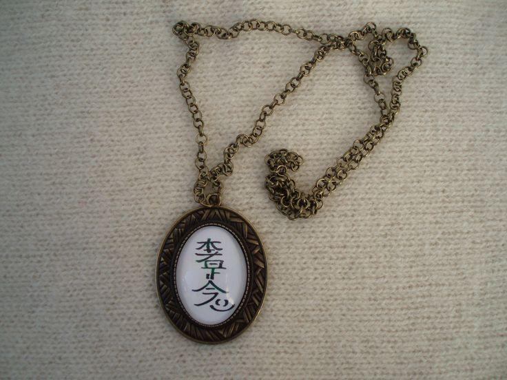 Colar com medalhão com o símbolo sagrado Hon-sha-Ze-cho-nen