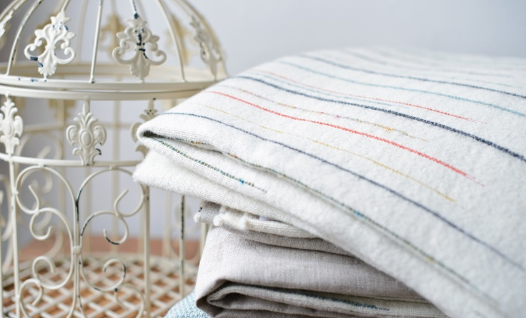 Chalkney throw by Laura Fletcher Textiles. 100% wool with linen lining.