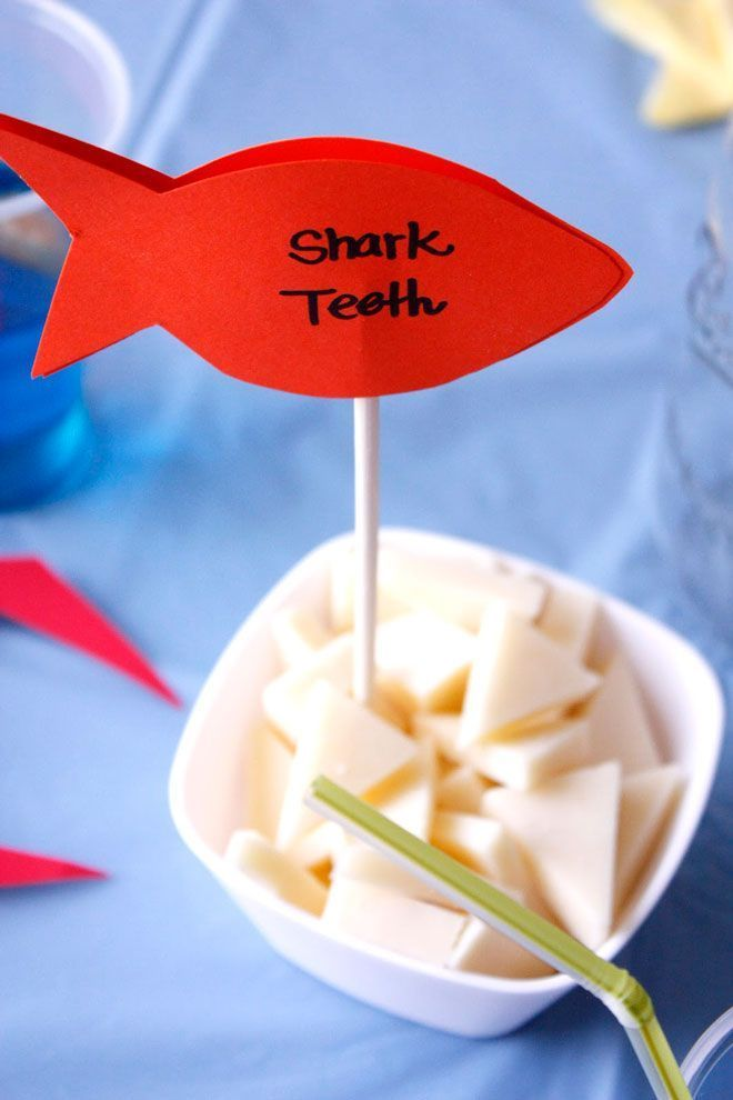 Cut cheese into triangles for an easy and creative party food! Great for an Under The Sea baby shower or birthday party.