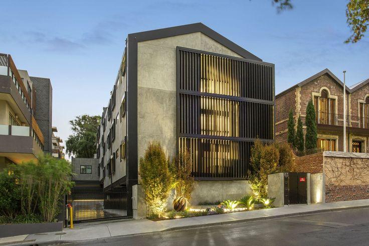 The Block Triple Threat - Featuring black Louvreline motorised vertical sun louvres & external venetian blinds