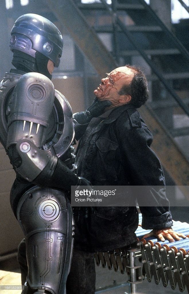 Peter Weller grabs Kurtwood Smith by the neck in a scene from the film 'RoboCop', 1987.